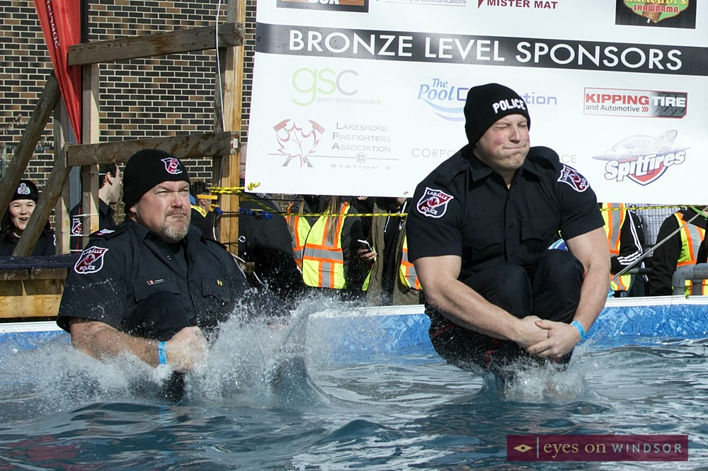 A pair of Town of Lasalle Police officers make a splash doing cannon balls into the Polar Plunge pool waters.