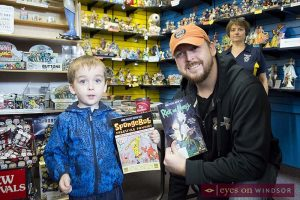 Father and son enjoy free comic book day at Cartoon Kingdom in Windsor, Ontario on May 6, 2017.