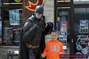 Batman Cosplayer with young boy during Free Comic Book Day 2017 at Windsor's Cartoon Kingdom.