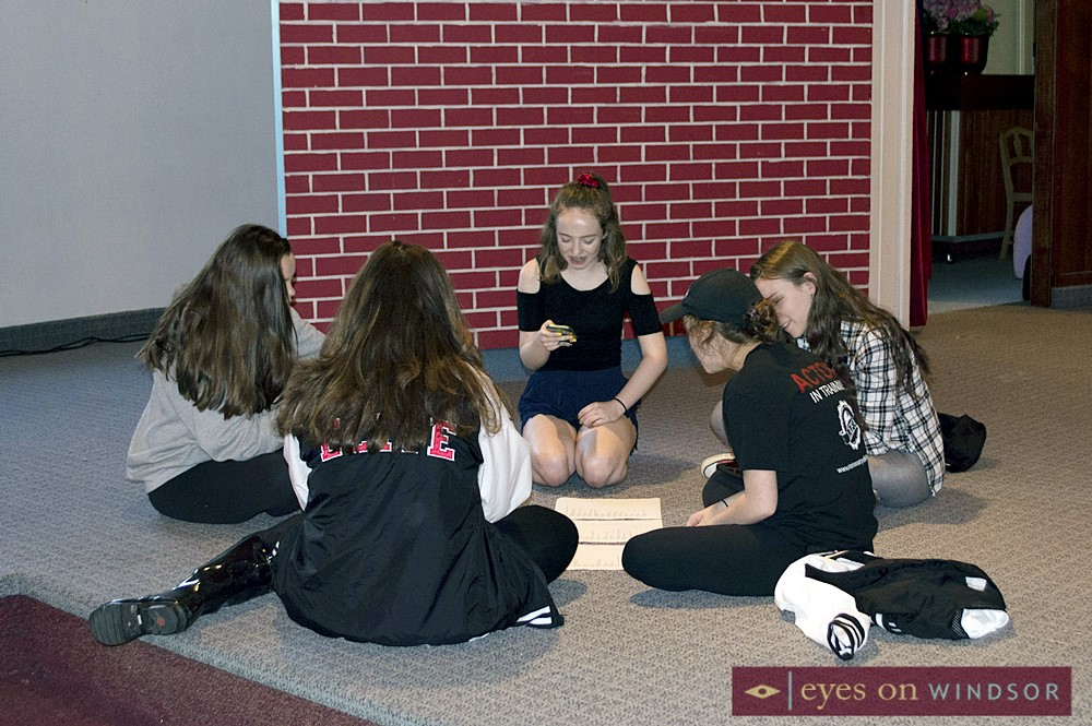 Students from LAFA Elite Theatre Group working on music and scripts together.