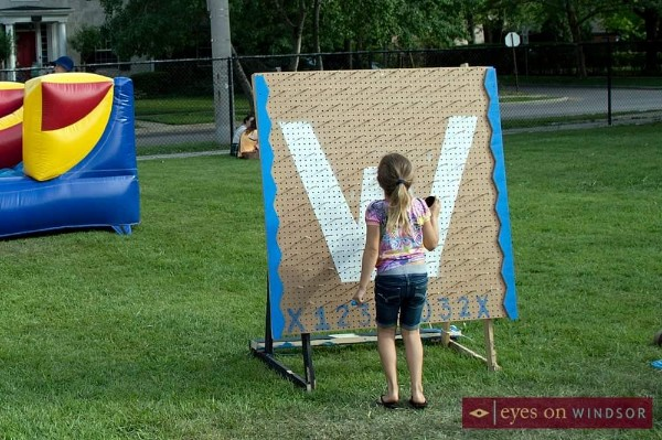 Young girl playing Plinko during the annual Walkerville Carnival
