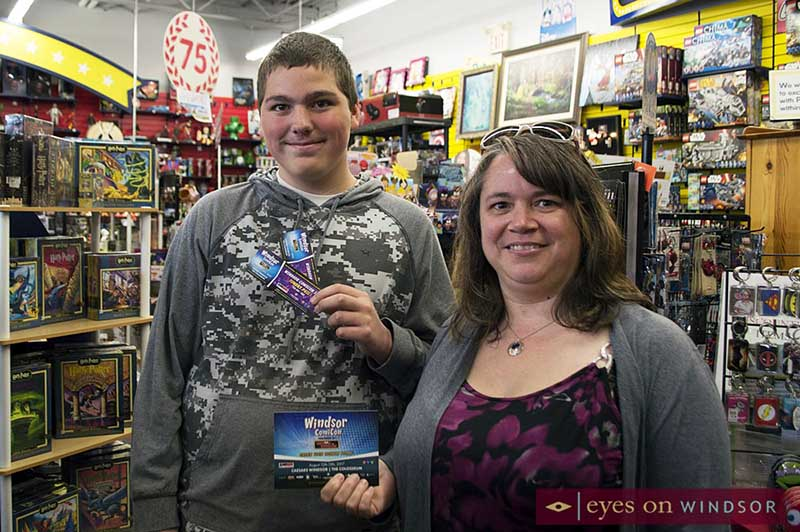 Teenage boy presented with Windsor ComiCon passes that he won during a draw held at Cartoon Kingdom in Windsor on Free Comic Book Day 2017.