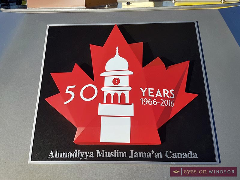 Ahmadiyya Muslim Jamā'at Canada 50 year plaque on peace sculpture in Windsor.