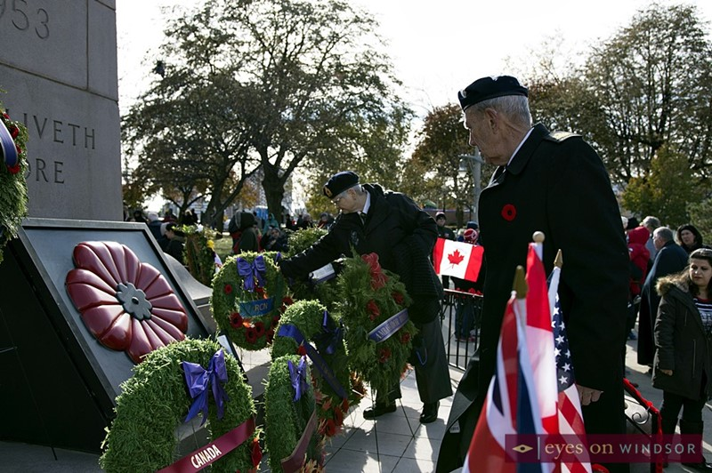Veterans looking at wreaths placed at Windsor cenotaph.