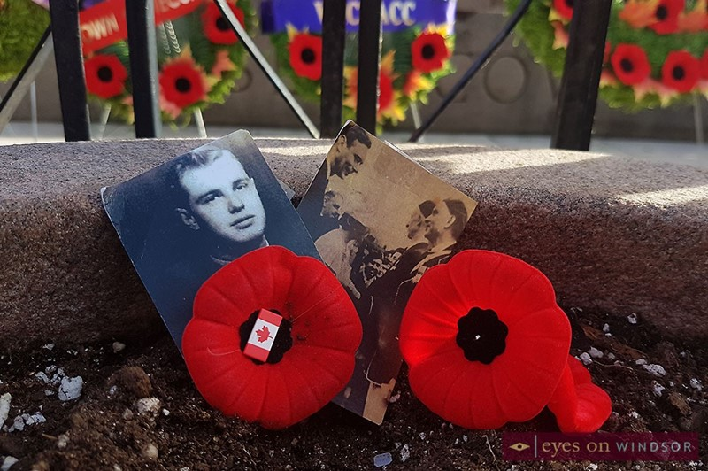 Photos of soldiers left by relatives at Windsor cenotaph during Remembrance Day service.