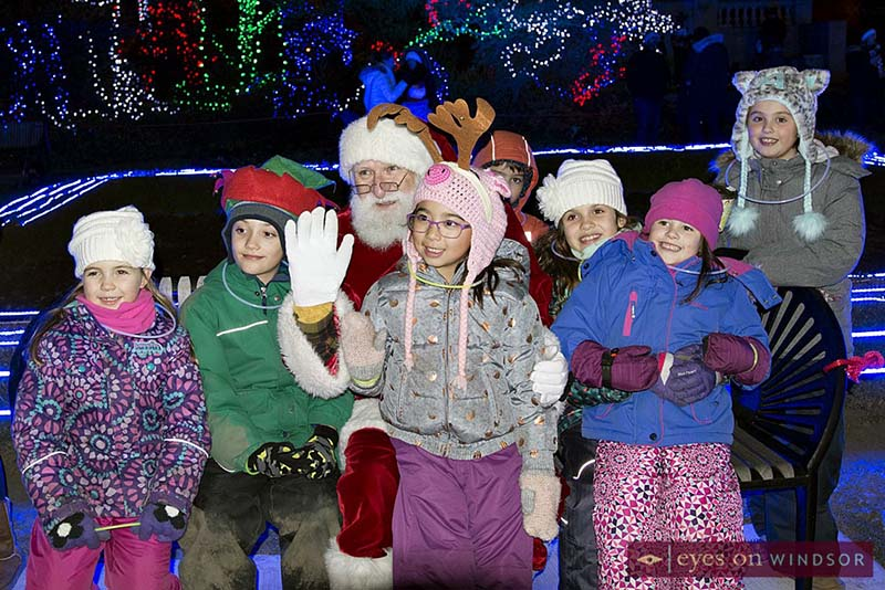 Children gather around Santa Claus during Bright Lights Windsor.