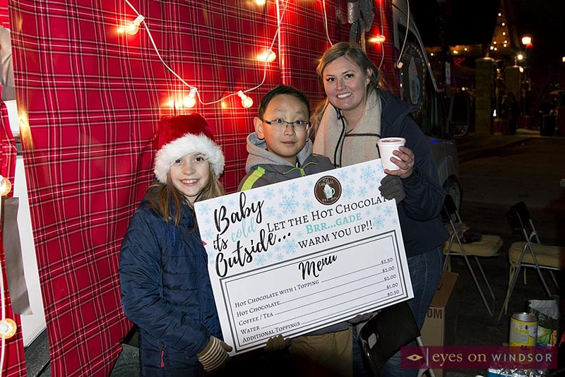 WE Care For Kids Foundation serving hot chocolate during Bright Lights Windsor.