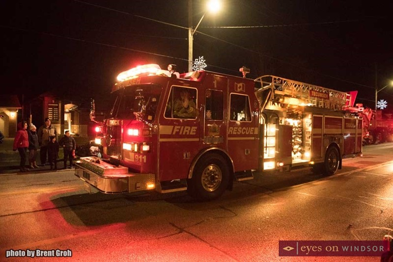 Tecumseh Fire Fighters in Their Firetruck Participating in the Christmas in Tecumseh Parade.