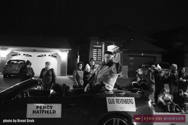 Percy Hatfield Waves To The Crowd As He Passes by During the Christmas in Tecumseh Parade.