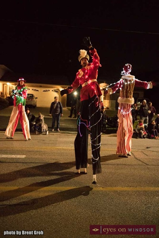 Stilt Guys take part in the Christmas in Tecumseh Parade.