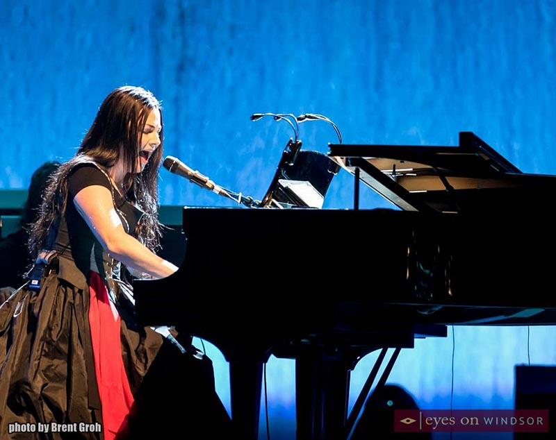 Amy Lee plays and sings at the piano.
