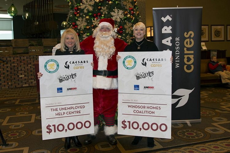 Santa Delivers $50K Gift On Behalf of S'Aints Sleighing Hunger Concert To Local Food Banks