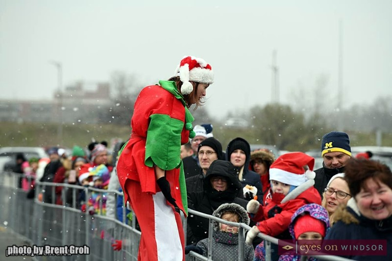 Top Shelf Elf (Stilt Guys) at Devonshire Mall Parking Lot During The Arrival of Santa Claus by Helicopter.
