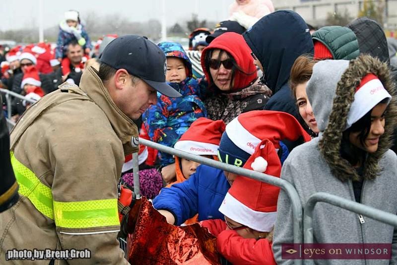 Windsor Firefighter Greets Children in Devonshire Mall Parking Lot.