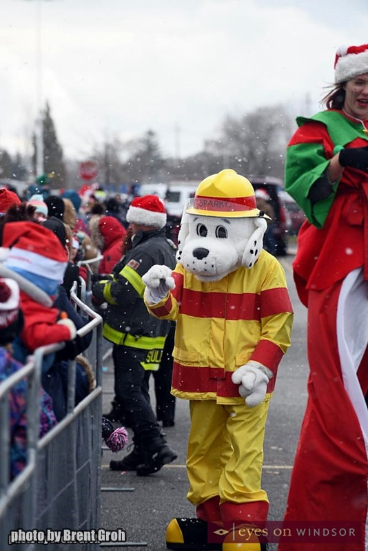 Sparky, Mascot of Windsor Firefighters Sparky's Toy Drive in Devonshire Mall Parking Lot During Santa's Arrival.
