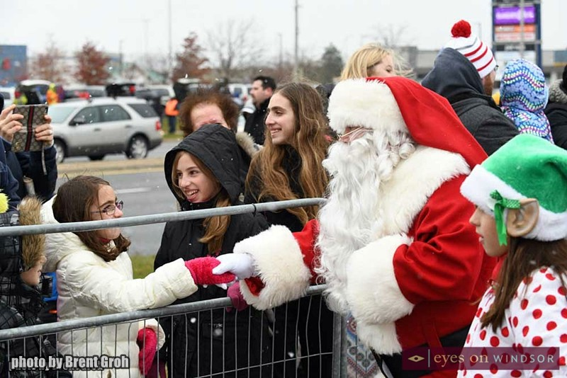 Santa Shakes Hands With A Young Girl in the Devonshire Mall Parking Lot.