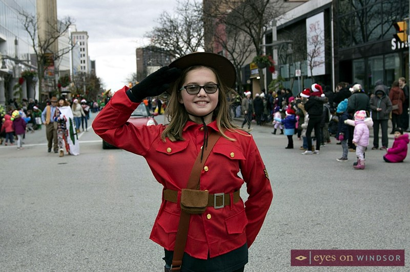 Young girl dressed as RCMP during Windsor Winter Fest Parade
