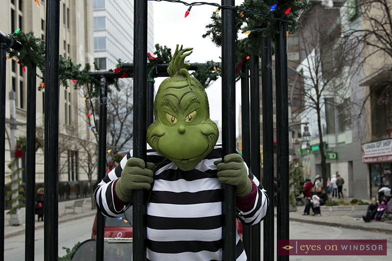 Crime Stoppers Windsor With The Grinch In Jail During Winter Fest Parade