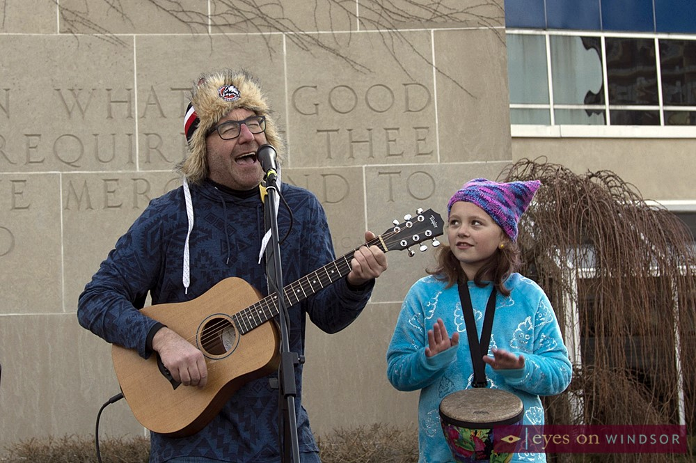 Don McArthur and his daughter Violet Sunshine perform during the Windsor Women's March at City Hall Square