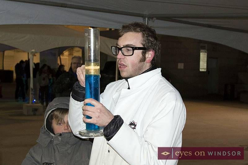 Mad Science Windsor putting on a demonstration for children during Earth Hour at Charles Clark Square
