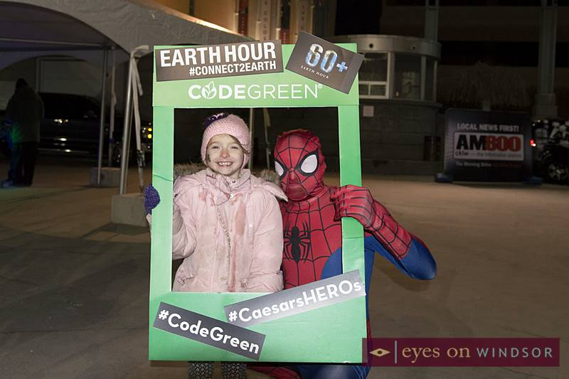 Young Girl Meets Spiderman in Windsor During Earth Hour.