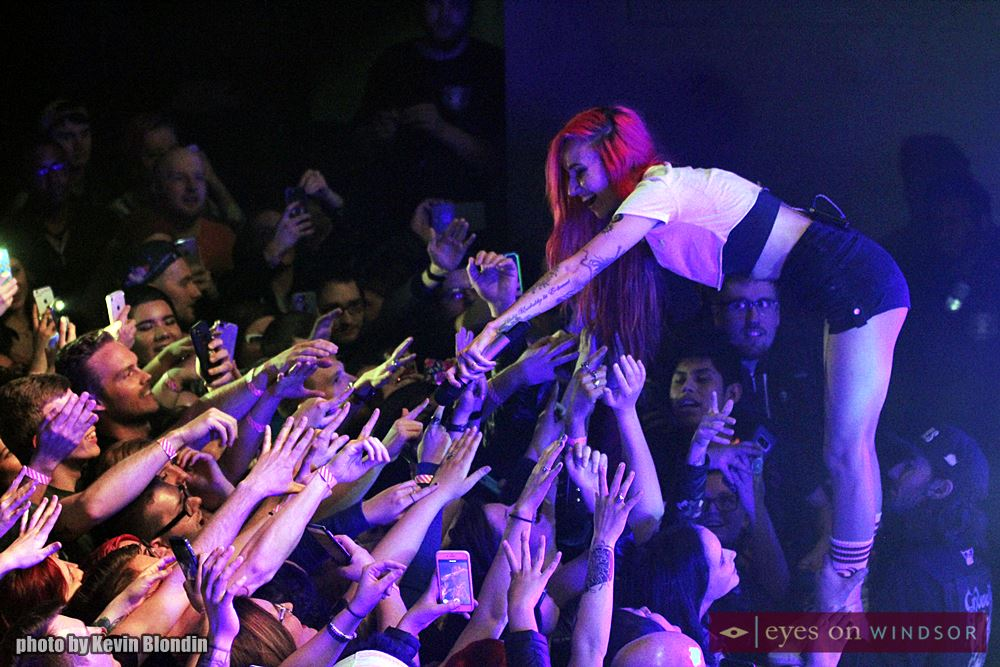 Lights interacts with fans as she performs on stage.