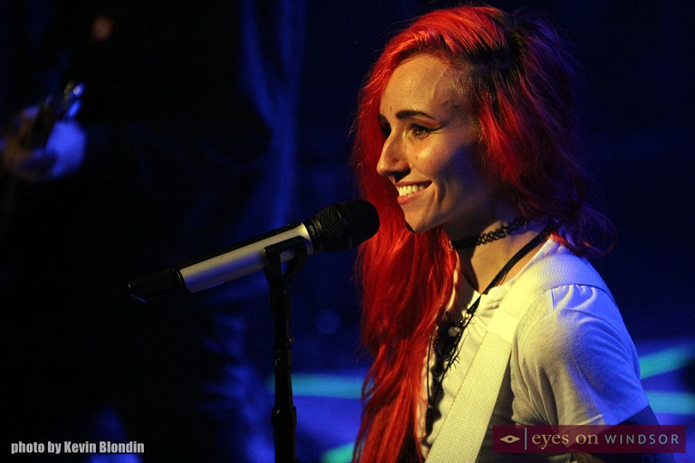 Lights smiles at fans while performing on stage.