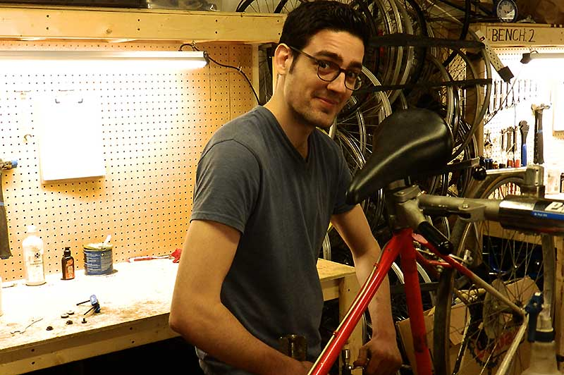 Nick Schmidt carries out maintenance duties on his bike at Windsor Bike Kitchen.