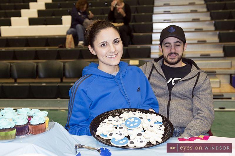 Nicole Tosti holds up tray of Polar Bear Polar Bear sugar cookies.