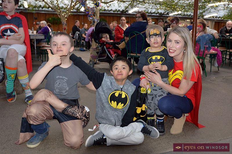 People dressed as superheros during Group Hug Apparel's Rock Your Socks fundraiser.