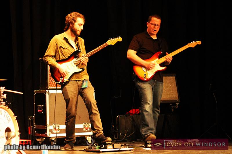 My Son The Hurricane guitarist Chris Sipos (left) performs with Windsor music teacher Dave Collins (right) for students at Corpus Christi Middle School