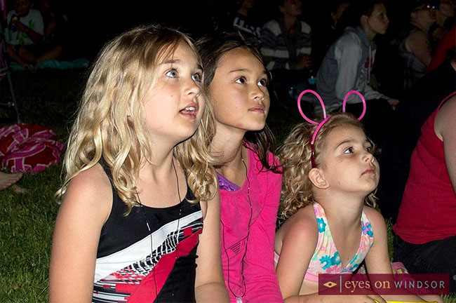 Children excitedly watching the annual Ford City Fireworks.