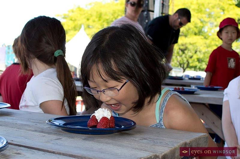 Young girl prepares for Strawberry Eating Contest at the Lasalle Strawberry Festival.
