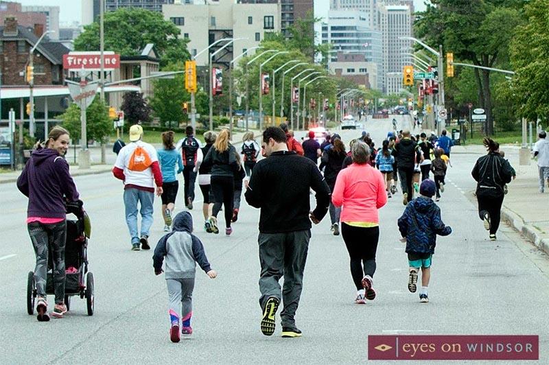 Mission Mile Run participants running down Ouellette Avenue.