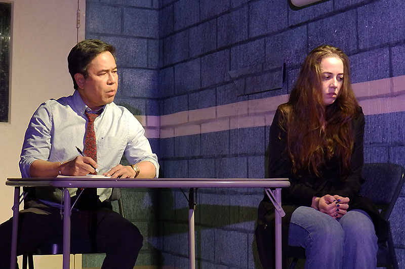 Alex Alejandria, cast as Detective Cole, rehearses Stop Kiss with Fay Lynn, cast as Callie.