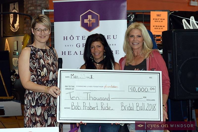Organizers of the annual Bridal Ball present a $10,000 check to the Bob Probert Ride.