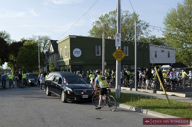 Cyclists prepare to begin the Ride of Silence in the parking lot of the Good Neighbour Restaurant.