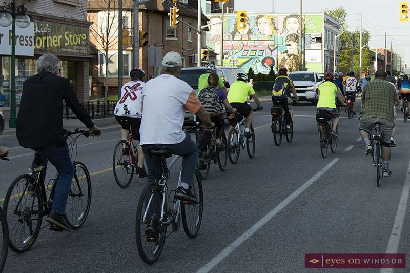 Windsor Ride of Silence cyclists travelling along Wyandotte Street in Walkerville