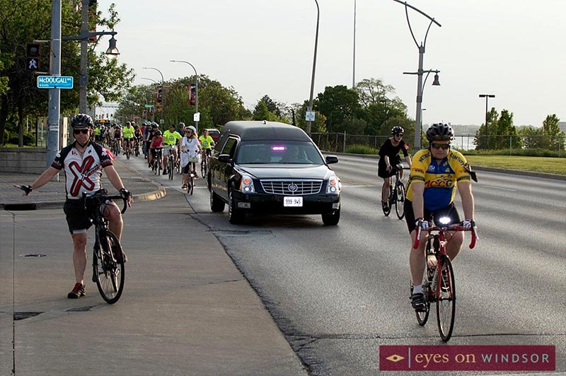 Hearse leads the annual Ride of Silence down Riverside Drive in Windsor, Ontario.