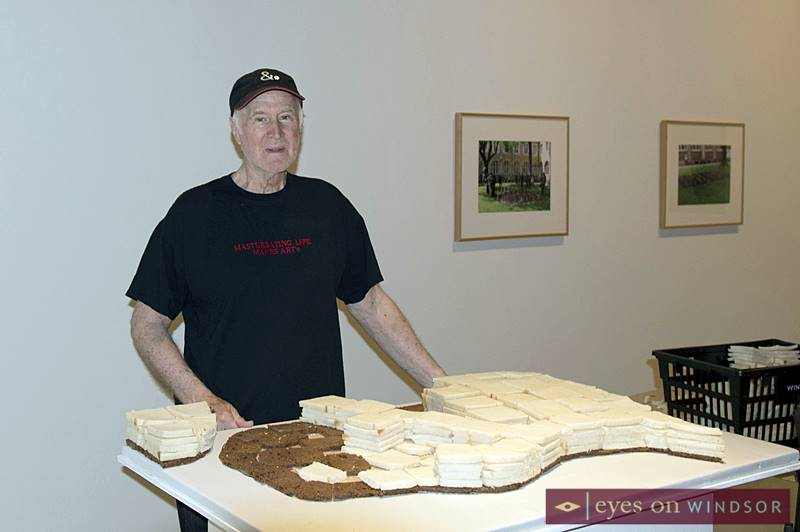 Iain Baxter& preparing a piece of art featuring Windsor-Essex County made out of bread,