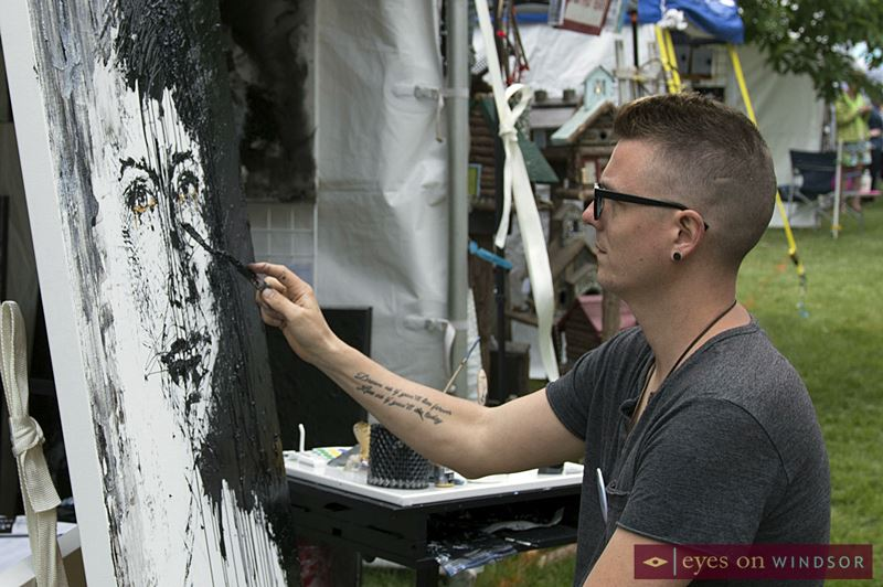 Artist Asaph Maurer painting during Art In The Park Windsor.
