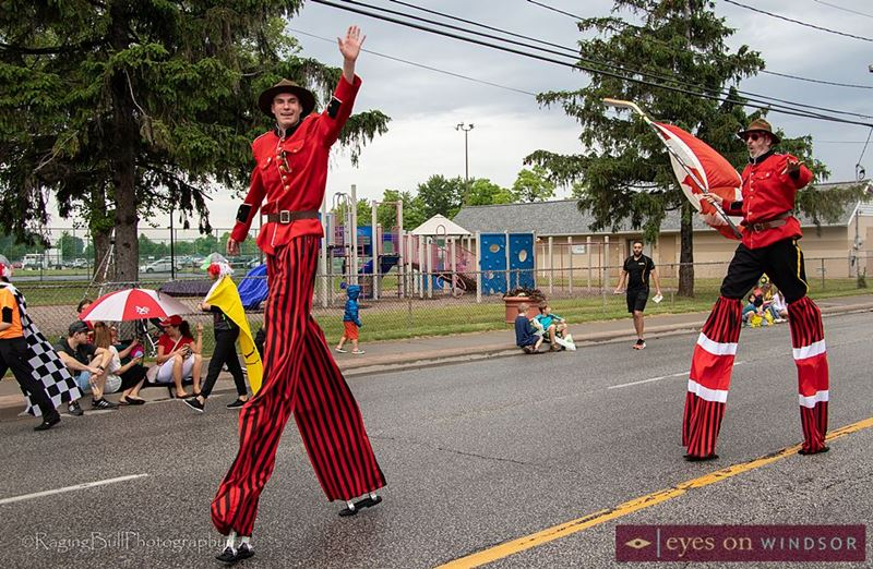 Stilt Guys participate in the Lasalle Strawberry Festival Parade.