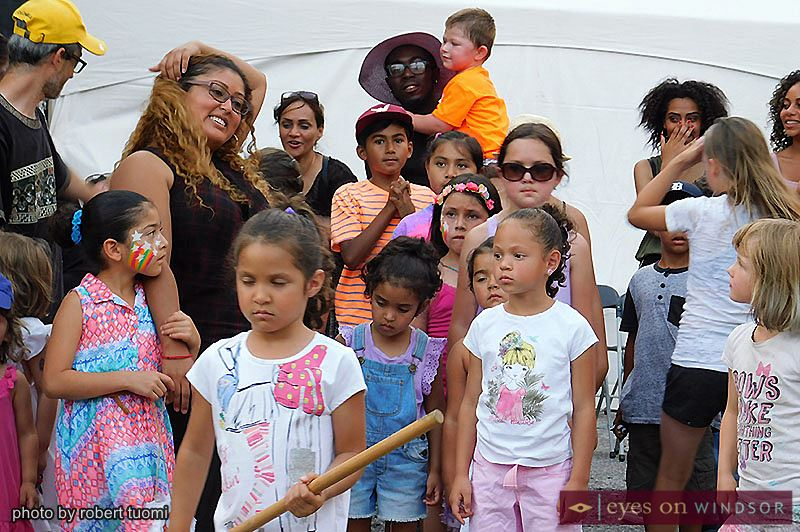 Children wait for their turn to beat the piñata during Fiesta Latina in downtown Windsor.