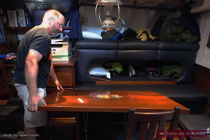 Lieutenant Sean Costello prepares the HMCS Oriole cabin's table for sea travel.