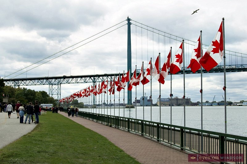 128 Canadian Flags along the riverfront after being unfurled during the Veterans Voices of Canada Flags of Remembrance in Windsor, Ontario