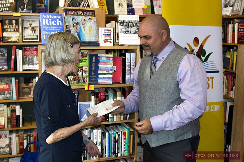 Greg Dehetre of Rotary Club of Windsor 1918 presents a check, part of the annual Walter Hadden Literacy Award, to Literary Arts Windsor president Lenore Langs,