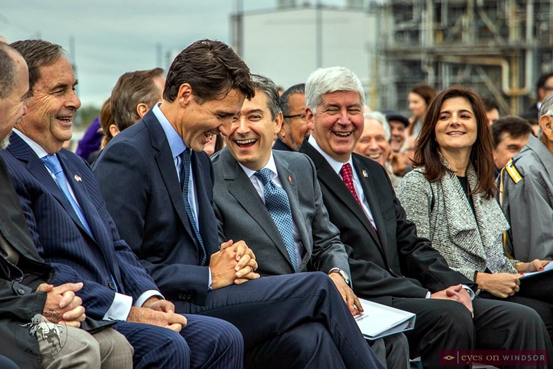 Dignatiaries laughing during Gordie Howe International Bridge construction start