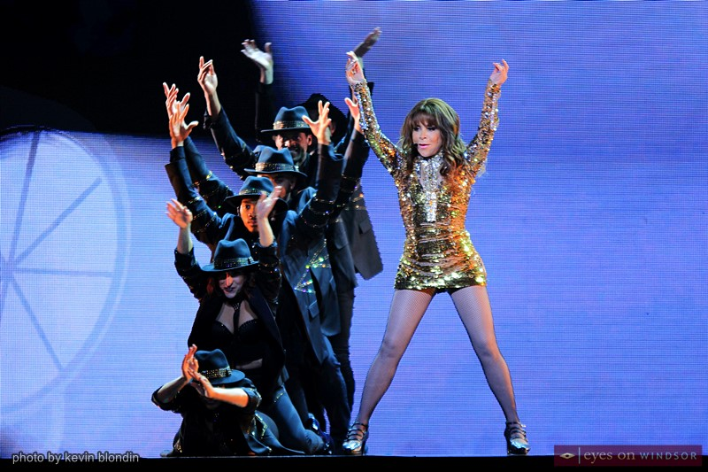Paula Abdul and dancers performing.