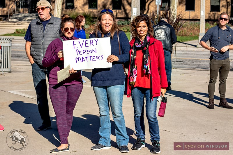 Sign stating Every Person Matters held up by a lady during Windsor Walk For The Homeless.