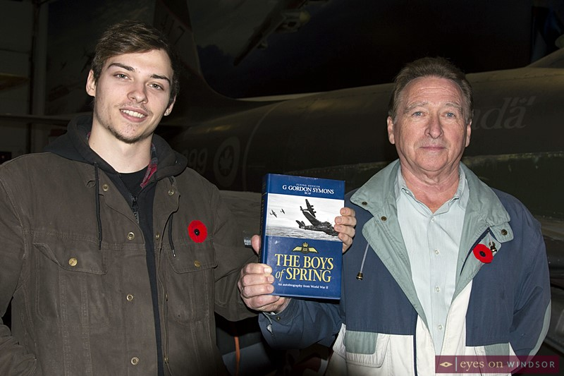 G. Gordon Symons WWII autobiography being held by his grand son Shawn (left) and son Robert Symons